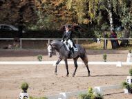 Jūlija Kosova ar zirgu Rhadamantus